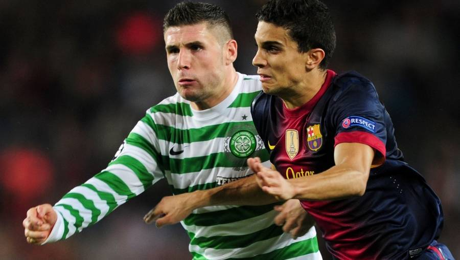 Marc Bartra i duel med Celtics Gary Hooper i Champions League-kampen for nylig. (Foto: PA/Adam Davy)