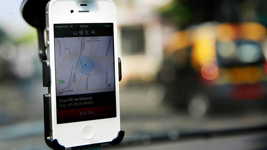 Hvis du har planer om at være utro, er det en ret dårlig idé at bruge Ubers app på ægtefællens telefon. Foto: Rafiq Maqbool/AP