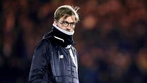 Klopp og Liverpool tabte hjemme til Swansea, som dermed kravlede op over stregen. Foto: AP